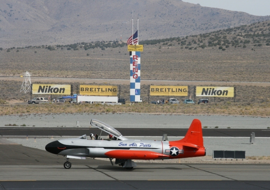 The T-33 chase plane taxiing past the Reno Air Races finish line 2012
