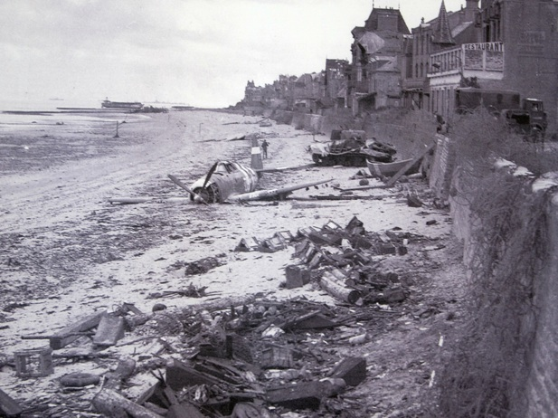 A crashed USAAF Republic P-47 Thunderbolt on the beach at Bernieres-sur-Mer, France June 1944