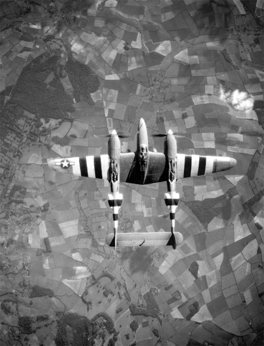 Great shot of a USAAF Lockheed P-38 Lightning with D-Day stripes 1944