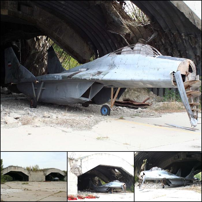 A surviving MiG-29 decoy at Batajnica Air Base in 2009 - note the bomb damage to the hardened aircraft shelter Serbian AF Yugo AF